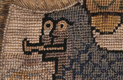 The head of 'A Lion of the Sea' from a motif on the Marian Needlework at Oxburgh Hall
