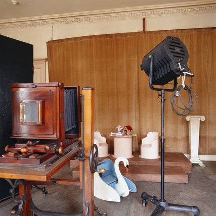 The Studio at 59 Rodney Street, Liverpool, the E. Chambre Hardman Studio, House and Photographic Collection - showing a large format camera, lights and a childrens background.