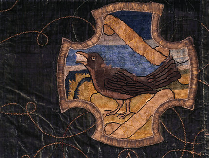 A bird similar to a thrush on a motif from the Matian Needlework at Oxburgh Hall