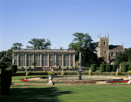 Belton House - View of the fountain in the Italian Garden & the Orangery, with the church of SS Peter & Paul (not NT) beyond
