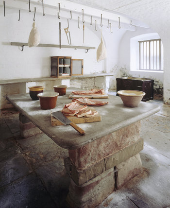 The Salting Room with large bellies of pork at Tatton Park where bacon carcasses and ham joints were salted to preserve them and then covered in muslin before being hung up.