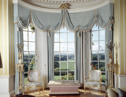 The Drawing Room at Hinton Ampner with views from the windows and heavily draped curtains