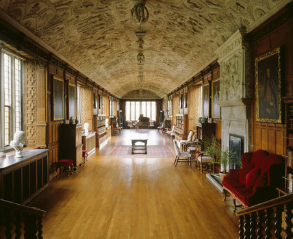 The Gallery at Lanhydrock looking towards the window at the end of the room, including the barrel-vaulted plaster ceiling c. 1642