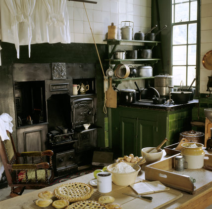 The kitchen at Wallington with close-up of the table set for making preserves and fruit pie