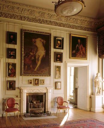 The Square Dining Room at Petworth with the C18th chimneypiece made of yellow and white Sienna marble