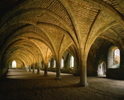 An interior view of the Cellarium at Fountains Abbey