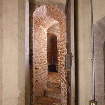 The Priest's Hole at Oxburgh Hall showing the doorway open