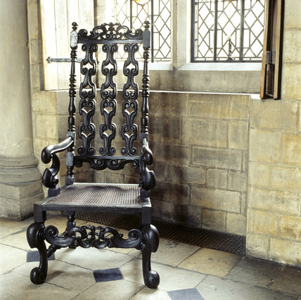 A carved armchair in the Great Hall of the Treasurer's House