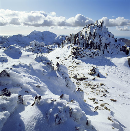 View Of The Snow Topped Summit Of Glyder Fawr Carneddau