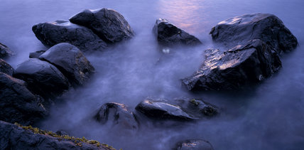 A circle of rocks in the sea at Drumnakill Point, Fair Head, County Antrim at sunrise