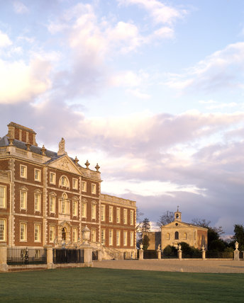 View of the south front of Wimpole Hall, captured in evening light