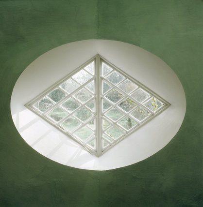A diamond shaped window at A la Ronde with a mint-green wall