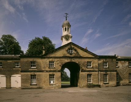 The Stable Block from the Courtyard, with the Cupola and clock, to a design by James Paine over the Entrance Archway