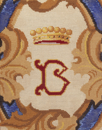 Detail of an embroidered initial on a chair in the Library