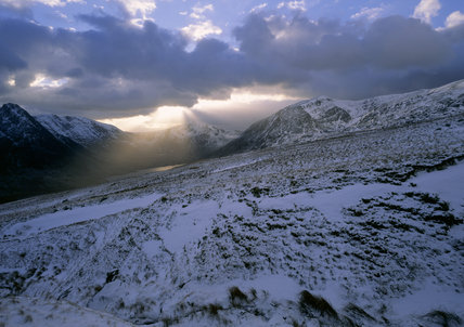Ogwen valley with Llyn Ogwen and the sun rays over Y Garn, Tryfan on the left and Pen yr Ole Wen on the right