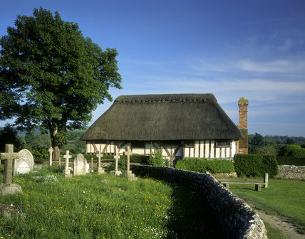 View of the west front of Alfriston Clergy House from the grave yard in East Sussex