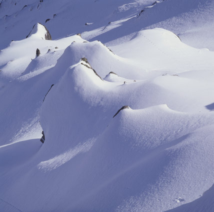 A close-up detail of snow formations below the summit if Y Garn