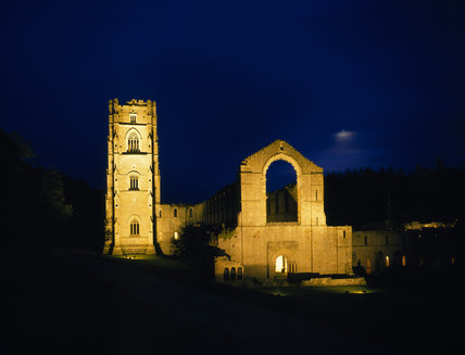 A floodlit view of the Old Cellarium of Fountains Abbey facing East
