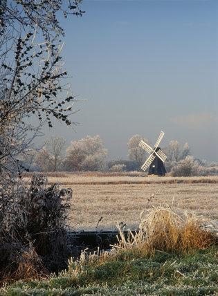 The restored windpump in Wicken Fen in the midst of a hoar frosted landscape