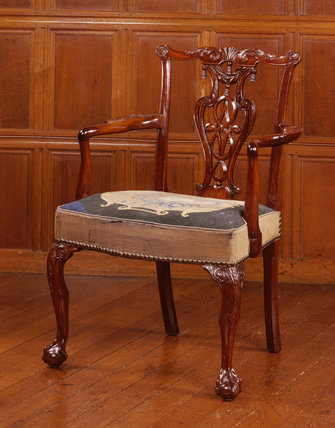Close-up of one of the mahogany dining carver chairs (c 1755)
