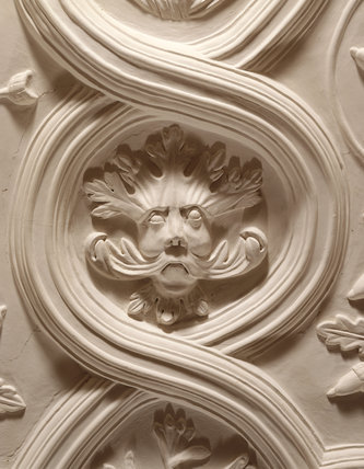 Detail of plasterwork frieze depicting the Green Man in the Long Gallery at Powis Castle