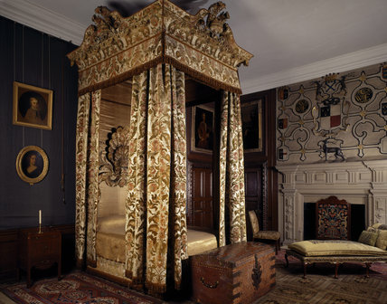 The magnificent four poster bed in the Cut Velvet Bedroom, named after the pink and green cut-velvet bed hangings dating from about 1740