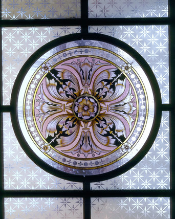 detail of glass ceiling light featuring a round painted