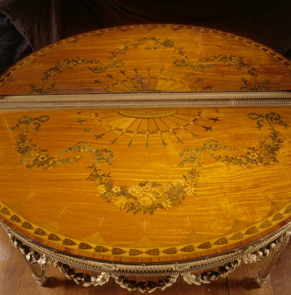 Close-up of one of the giltwood pier tables and pier glasses made by Ince and Mayhew of London in 1782, in the Saloon at Chirk Castle