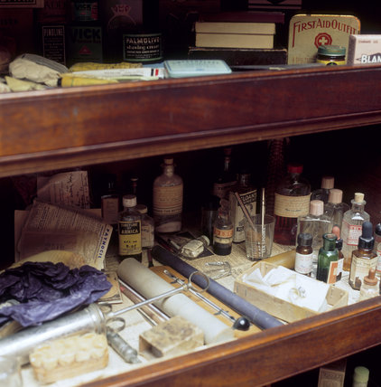 Detail of the medicine cabinet containing bottles and ointments in the Turret Landing at Sunnycroft
