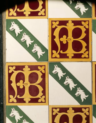 Detail of Minton encaustic tiles in the fireplace in the Long Gallery at Chirk Castle