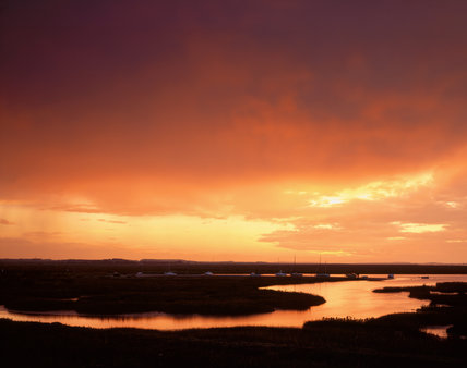 A spectacular glowing sunset over the tidal estuary at Blakeney Point