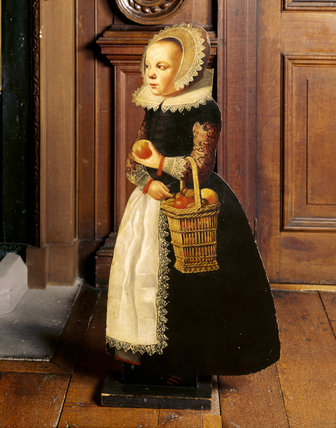 Close-up of Flemish dummy-board figure of a little girl holding a basket of fruit, c 1600
