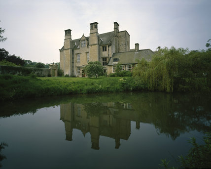 The East Front of Nunnington Hall reflected in the River Rye