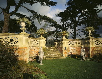 View of statues in the forecourt at Charlecote with wall and stepped gateway behind
