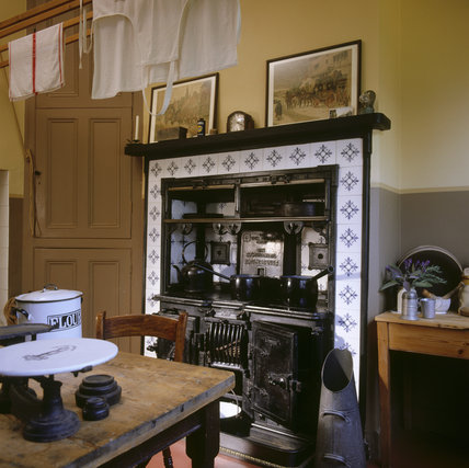 View of the Kitchen at Shaw's Corner showing the range and tables