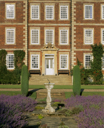 View of the entrance front of Gunby Hall from the garden path with the sundial in the foreground