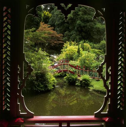 Looking through a window in the China Temple to a pond & bridge, in Biddulph Grange Garden