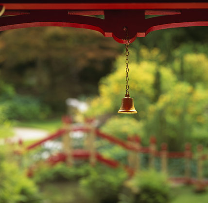 A golden wind chime, on the corner of the China Temple, in China, part of Biddulph Grange Garden