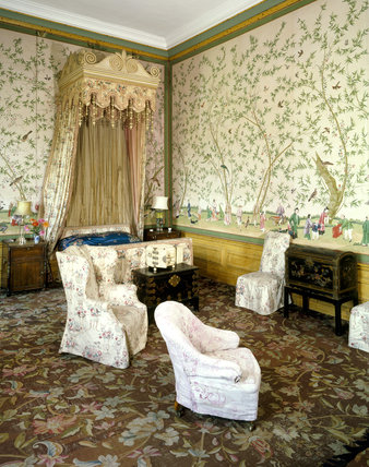 The interior of the Chinese Bedroom at Belton House, bed, dado and cornice painted to imitate bamboo