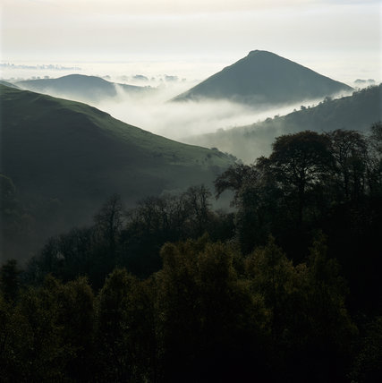 Thorpe Cloud rises above the morning mists of Dovedale White Peak