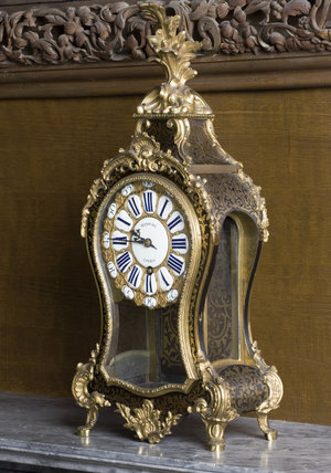 Ormolu-mounted Boulle bracket clock (1715-1723) by Minoche of Paris in the Carved Room at Petworth House, West Sussex