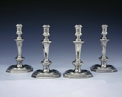 Four chapel candlesticks by Isaac Liger, 1708, (DUN.S.286), part of the silver collection at Dunham Massey, photographed for the Country House Silver book.