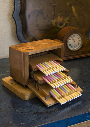 Wooden cigarette box with coloured cigarettes in the Dining Room at Coleton Fishacre, the house designed in 1925 for Rupert and Lady Dorothy D'Oyly Carte at Kingswear, Devon
