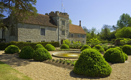 The West Front at Ightham Mote, Sevenoaks, Kent, a fourteenth-century moated manor house, from the garden