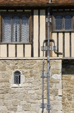 Detail of timber, windows and drainpipe on the South Front at Ightham Mote, Sevenoaks, Kent, a fourteenth-century moated manor house
