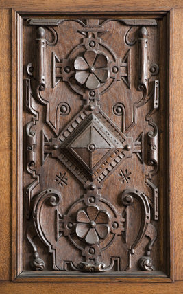 Close view of part of the wooden carving on the door panels of the Library in the new house at Scotney Castle, Kent