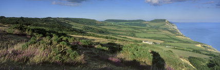 Looking east, over the cliff tops, to Golden Cap, with Chesil Beach and Portland in the distance