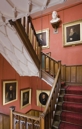 The Staircase with portrait paintings from Disraeli's Gallery of Friendship at Hughenden Manor, Buckinghamshire, home of prime minister Benjamin Disraeli between 1848 and 1881