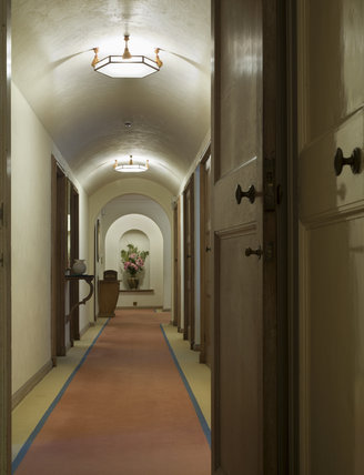 The Upstairs Corridor with Art Deco lampshades at Coleton Fishacre, the house designed in 1925 for Rupert and Lady Dorothy D'Oyly Carte at Kingswear, Devon