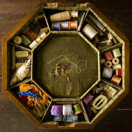 Octagonal needlework box with buckles, thread, cotton reels and a thimble in the Parlour at Plas yn Rhiw, Pwllheli, Gwynedd